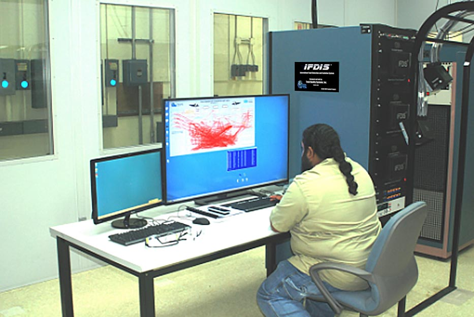 Electronics integrated systems mechanic Moses Simms readies the Intermittent Fault Detection and Isolation System